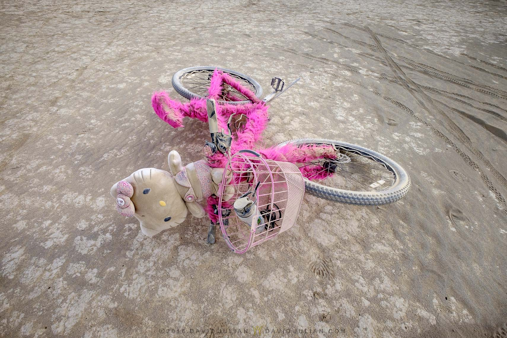 Abandoned Hello Kitty bike in deep playa-