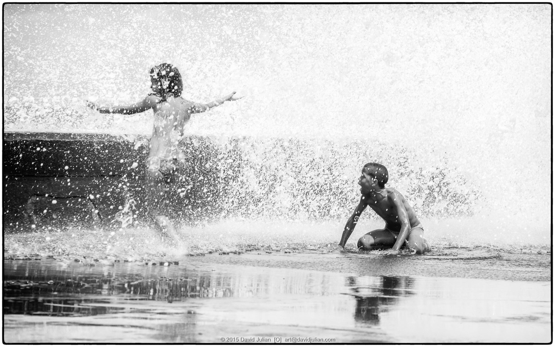 CUBA, Havana, Malecon kids in spray